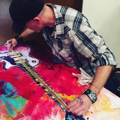 Roy Laws art, Painter of Music, live entertainment; live painting a guitar, adding strings; Nashville, TN