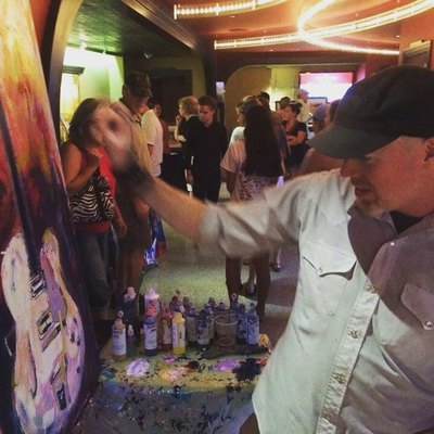 Roy Laws art, Painter of Music, live entertainment; live painting guitar during an event; Music City