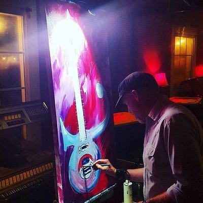 Roy Laws art, Painter of Music, live entertainment; live painting a guitar used by Prince