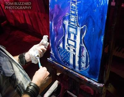 Roy Laws art, Painter of Music, live entertainment; live painting a guitar with US flag; Nashville, TN
